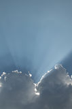 Cloud. With rays of the sun and the recess in the form of a triangle Royalty Free Stock Image