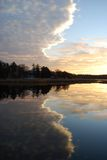 Cloud reflected in a water. Sunset. Stock Images