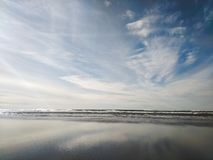 Cloud reflection on beach stock photo