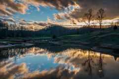 Cloud Reflection on Lake at Golf Course with Bridge Royalty Free Stock Photography