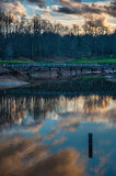 Cloud Reflection on Lake at Golf Course with Bridge Royalty Free Stock Images