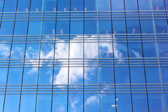 Cloud reflection in office building windows. Royalty Free Stock Photography