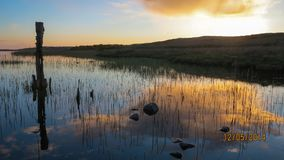 Cloud reflection. Cloud reflected in loch on the Isle of Colonsay Stock Photo
