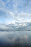 Cloud reflection on wet shoreline - Series 2 Royalty Free Stock Photos