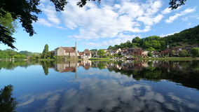 Cloud reflections in Dordogne River at Beaulieu sur Dordogne, Correze, Limousin stock video