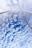 Cloud reflections on glass wall Royalty Free Stock Photo