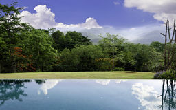 Cloud reflections on the infinity pool with beautiful landscape Royalty Free Stock Photos