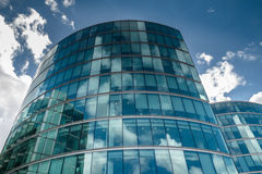 Cloud reflections on a modern glass building Royalty Free Stock Photography