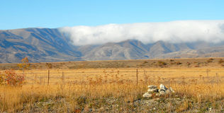 Cloud rolling over Hawkdun Range, new Zealand Royalty Free Stock Photos