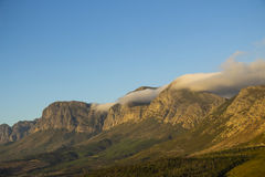Cloud rolling over mountain at Sir Lowry's Pass Royalty Free Stock Photos
