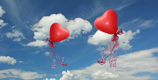 Cloud scape with two red heart shaped balloons Royalty Free Stock Photos
