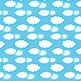 Cloud seamless pattern on blue background. Vector illustration. Royalty Free Stock Photography