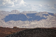 Cloud shadow in Nevada. A cloud casts its shadow on a mountain in Nevada royalty free stock photography