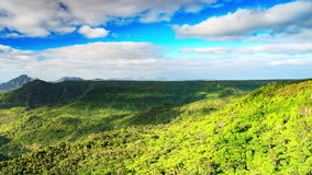 Cloud shadows over tropical rainforest covered hills timelapse stock video