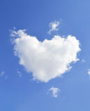 Cloud in the shape. A heart on blue sky royalty free stock image