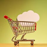 Cloud shape inside shopping cart Stock Images
