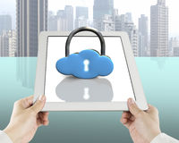 Cloud shape lock on tablet with hand holding Royalty Free Stock Photo
