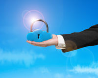 Cloud shape locker on hand with sunlight Stock Photos