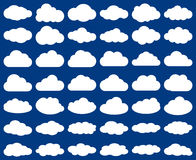 Cloud shape. Vector set of clouds silhouettes isolated  on blue Royalty Free Stock Images