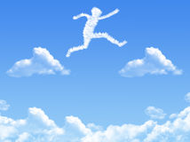 Cloud shaped as  jump Royalty Free Stock Photos