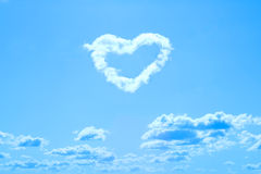 Cloud shaped like heart. On blue sky Stock Photography