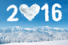 Cloud shaped numbers 2016 and heart Stock Photo