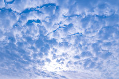 Cloud shielding the sun with the blue temp filter Royalty Free Stock Image