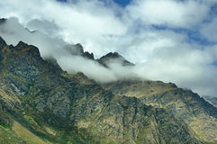 Cloud Shrouded Mountain Ridge Stock Photos