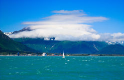 Cloud shrouded mountains, Seward Alaska Royalty Free Stock Photos