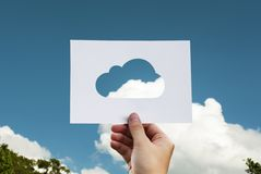 Cloud silhouette against blue skies Stock Images