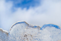Cloud Similar ice sculpture. With a blue sky with clouds. The sky reflects in the ice Stock Photo