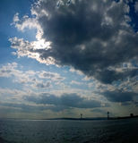 Cloud skies over Verrazano Bridge. A panorama image of cloudy skies over Verrazano Bridge and The Narrows Royalty Free Stock Images