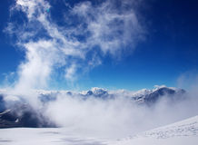Cloud on sky. Cloud on background of the snow mountains. Natural composition Stock Photo