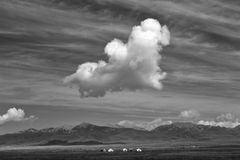 Cloud in the sky above steppe. The cloud looks like a dog in the sky. It's taken in Ruoergai steppe in sichuan Stock Image