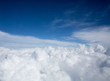Cloud sky behind airplane window Royalty Free Stock Photography