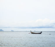 Cloud sky boat and the sea. Abstract lifestyle fishermen. Royalty Free Stock Image