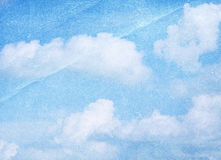 Cloud and sky on crumpled paper. Stock Photography
