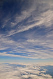 Cloud in the sky. Layers of cloud in the blue sky viewed from within an aircraft Royalty Free Stock Photo
