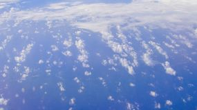 Cloud view above from airplane window stock photo