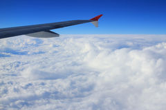 Cloud sky view from air plane window next to a wing Royalty Free Stock Images