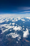 Cloud sky view from airplane. Cloud sky from airplane as seen through window royalty free stock images