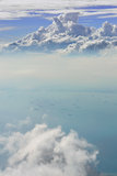 Cloud sky view from airplane. Cloud sky from airplane as seen through window. Vertical version Royalty Free Stock Photos
