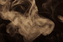 Cloud of smoke on black background. Selective focus. Toned Stock Images