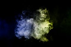Background from the smoke of vape. Cloud of smoke of blue and green isolated background. Background from the smoke of vape Stock Image
