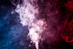 Background from the smoke of vape. Cloud of smoke of blue and red  isolated background. Background from the smoke of vape Stock Photo
