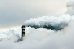 cloud of smoke coming out of  power plant chimney, pollution Royalty Free Stock Images