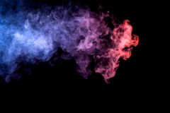 Background from the smoke of vape. Cloud of smoke of purple, red and blue colors on black  isolated background. Background from the smoke of vape Stock Image