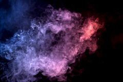 Background from the smoke of vape. Cloud of smoke of purple, red and blue colors on black  isolated background. Background from the smoke of vape Royalty Free Stock Photo