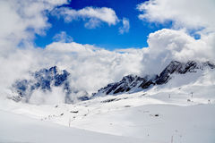 Cloud & Snow on Zugspitze. Clouds & snow on Zugspitze with view of ski area Royalty Free Stock Photos
