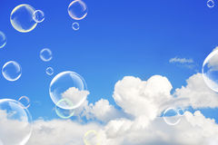 Cloud and soap bubbles stock image